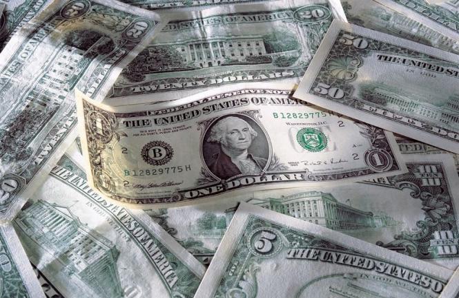 Доллар встречает новый год с подавленным настроением