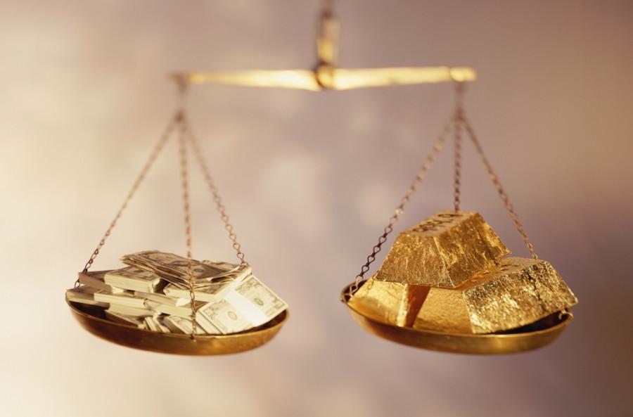 Доллар пытается перекрыть золоту кислород, но оно не сдается