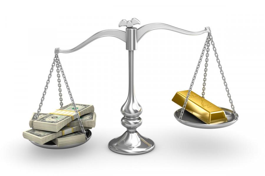 Золото не может поймать волну роста из-за колебаний доллара